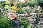 rock walls outline a two level terraced area that has been backfilled with topsoil, landscape cloth and eight inches of gravel