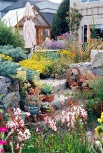 Plinth surrounded by mixed plantings full of fragrance, texture, colour and movement painted in the soft colours and grey foliage of the Mediterranean